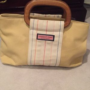 Khaki colored VV purse with wood handles